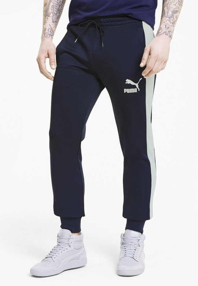 ICONIC  - Tracksuit bottoms - peacoat