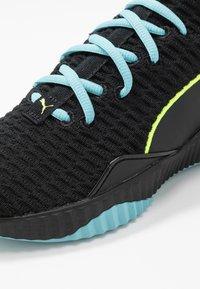 Puma - DEFY - Gym- & träningskor - black/milky blue - 5