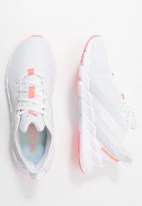 Puma - WEAVE XT - Obuwie do biegania Stabilność - white/ignite pink/fizzy orange - 1