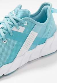Puma - WEAVE XT - Stabilty running shoes - milky blue/white - 5