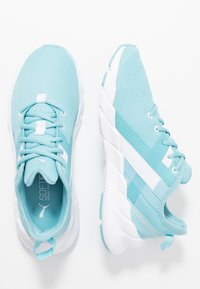 Puma - WEAVE XT - Stabilty running shoes - milky blue/white - 1