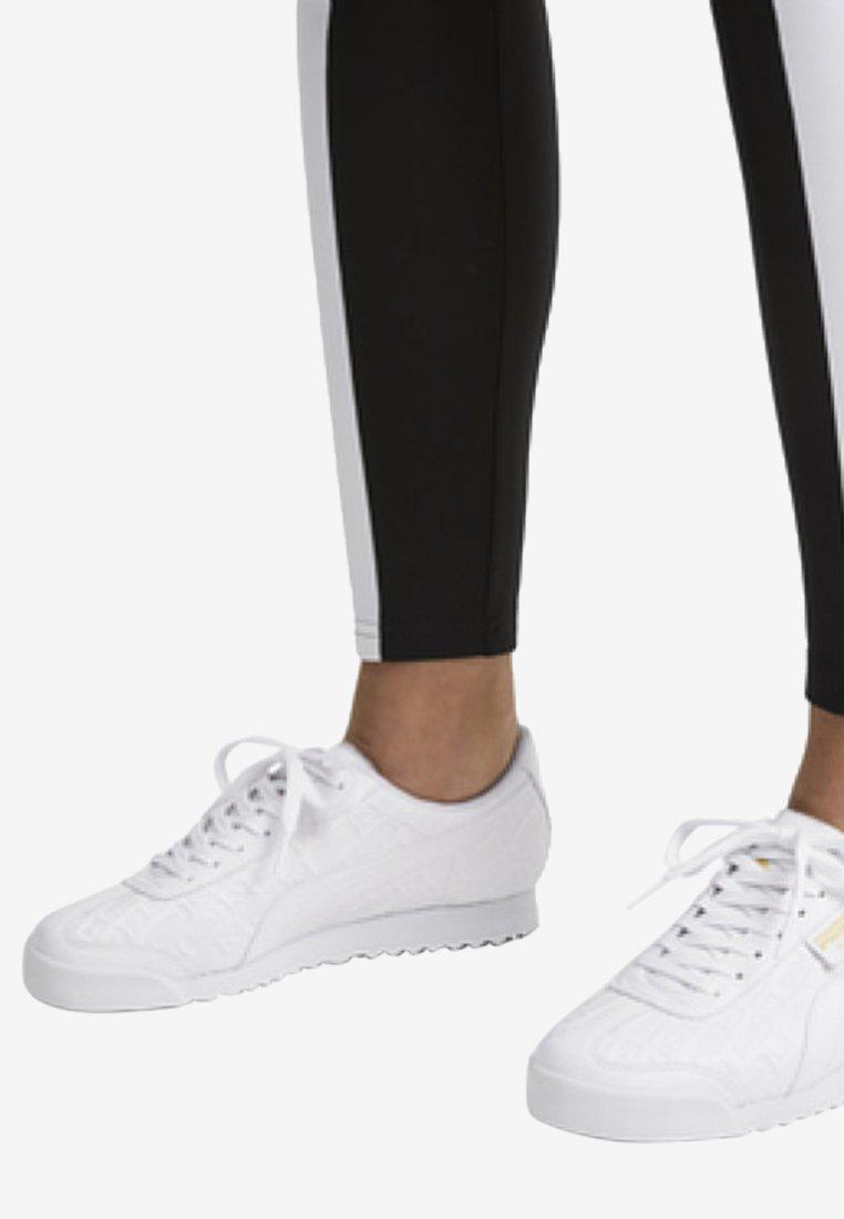 Puma - ROMA REINVENT - Sports shoes - white