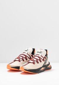 Puma - LQDCELL SHATTER TR FM  - Sports shoes - tapioca/black - 2