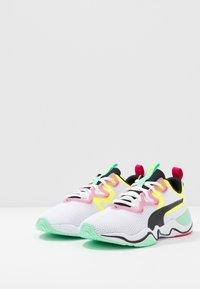 Puma - ZONE XT - Sports shoes - white/black/yellow alert - 2