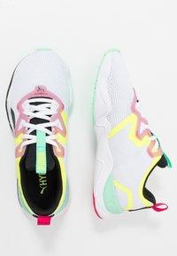 Puma - ZONE XT - Sports shoes - white/black/yellow alert - 1