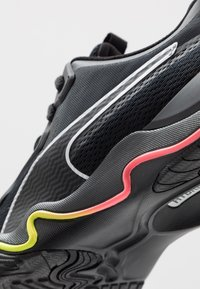 Puma - ZONE XT - Sports shoes - black/ignite pink/silver - 5
