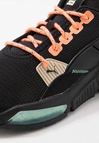 Puma - LQDCELL OPTIC FM - Neutral running shoes - black/fizzy orange - 5