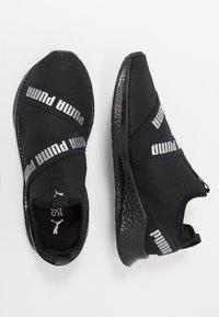 Puma - NRGY STAR SLIP-ON - Neutrální běžecké boty - black/silver - 1