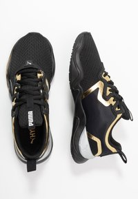 Puma - ZONE XT METAL - Zapatillas de entrenamiento - black/gold - 1