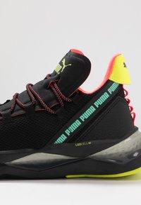 Puma - LQDCELL SHATTER TR - Sports shoes - black/yellow alert - 5