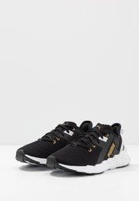 Puma - WEAVE XT METAL - Sportovní boty - black/metallic gold - 2