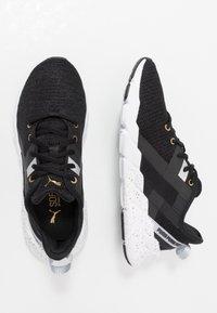 Puma - WEAVE XT METAL - Sportovní boty - black/metallic gold - 1