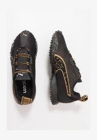 Puma - METAL WN'S - Obuwie do biegania treningowe - black/metallic gold - 1
