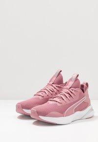 Puma - SOFTRIDE RIFT - Neutral running shoes - foxglove/white - 2