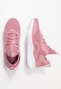 Puma - SOFTRIDE RIFT - Neutral running shoes - foxglove/white - 1