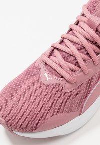 Puma - SOFTRIDE RIFT - Neutral running shoes - foxglove/white - 5