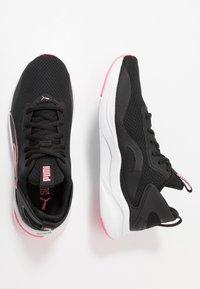 Puma - SOFTRIDE RIFT - Neutrální běžecké boty - black/luminous peach - 1