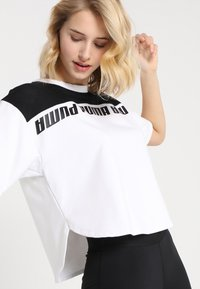 Puma - MODERN SPORTS TEE - Print T-shirt - white/black - 3