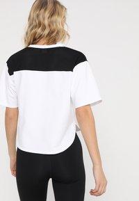 Puma - MODERN SPORTS TEE - Print T-shirt - white/black - 2