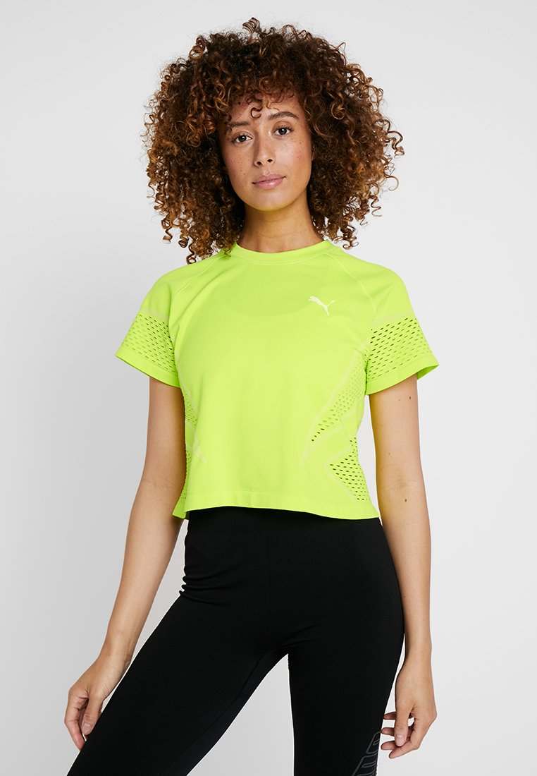 Puma - SEAMLESS LOOSE LAYER TEE - T-Shirt print - safety yellow