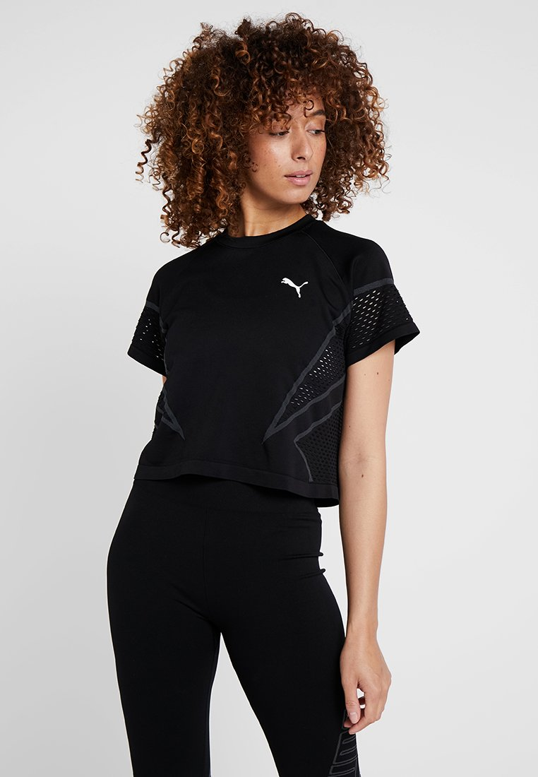 Puma - SEAMLESS LOOSE LAYER TEE - T-Shirt print - black