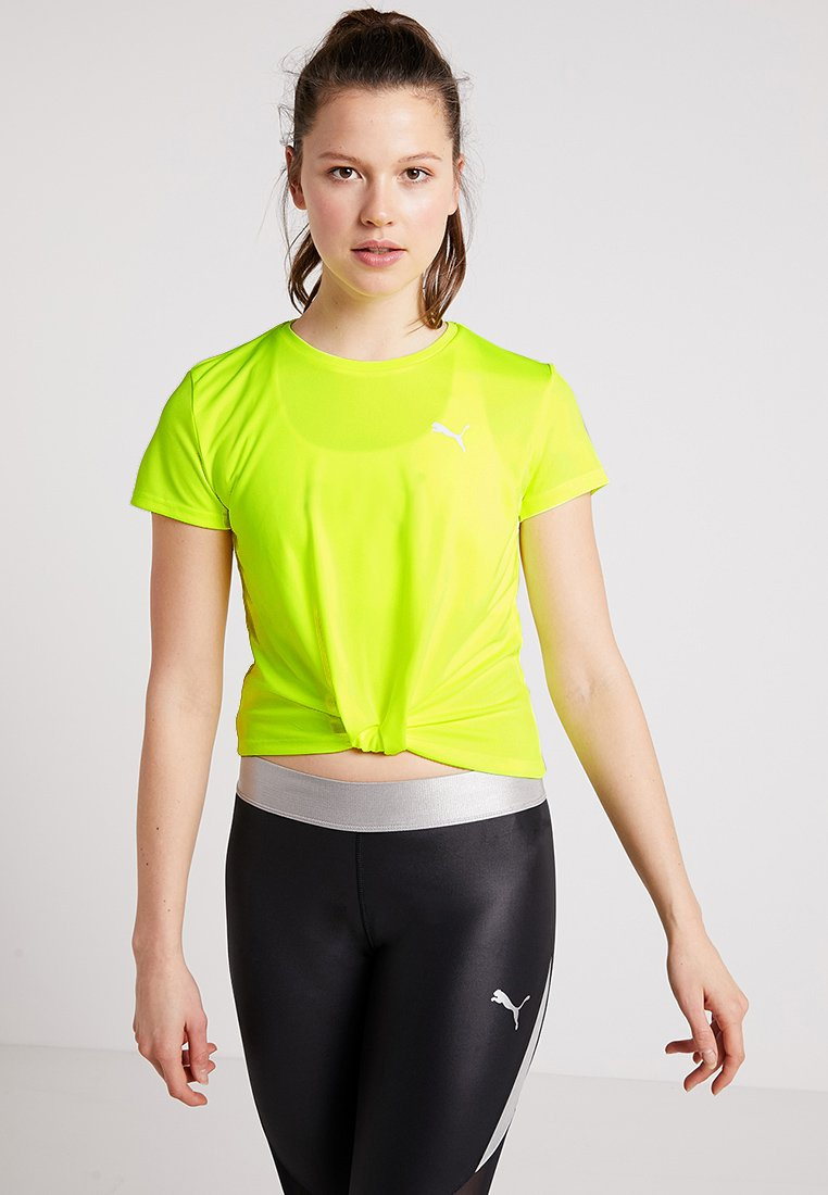 Puma - TWISTED TEE - T-shirt - bas - safety yellow