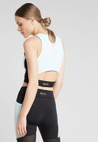 Puma - CROP - Top - fair aqua/black - 2