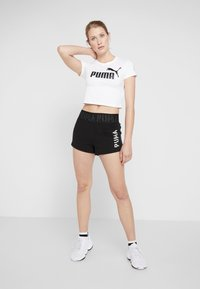 Puma - AMPLIFIED LOGO FITTED TEE - Print T-shirt - white - 1