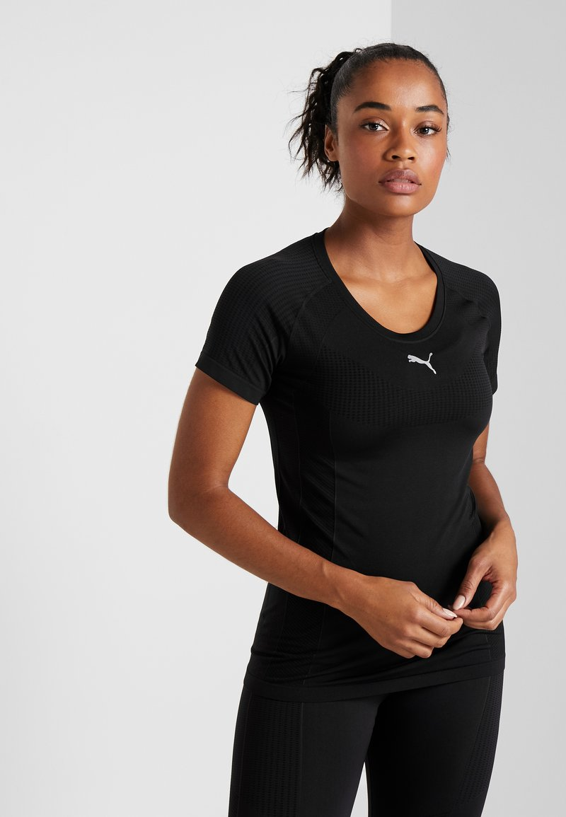 Puma - CORE SEAMLESS TEE - T-shirts med print - black