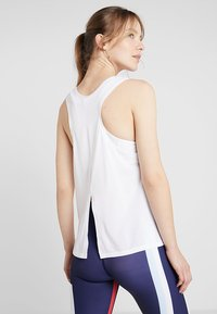 Puma - HIT FEEL IT TANK - Koszulka sportowa - white