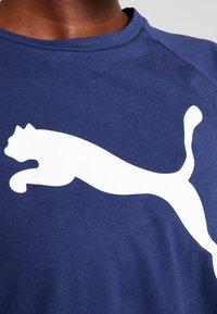 Puma - PAMELA  REIF X PUMA BOXY TEE - T-shirt con stampa - blue depths - 6