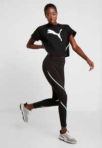 Puma - PAMELA  REIF X PUMA BOXY TEE - T-shirts med print - black - 1