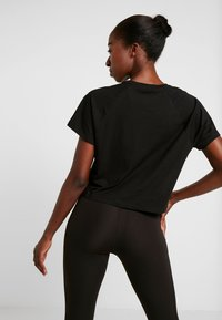 Puma - PAMELA  REIF X PUMA BOXY TEE - T-shirts med print - black - 2