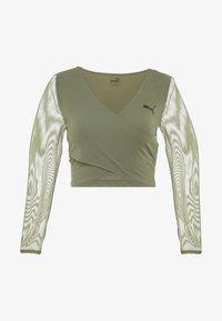 Puma - PAMELA REIF X PUMA CROPPED LS TOP - Sports shirt - four leaf clover - 4