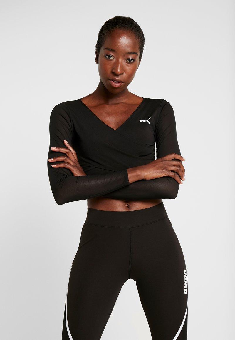 Puma - PAMELA REIF X PUMA CROPPED LS TOP - Sports shirt - black