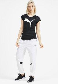 Puma - T-shirt imprimé - black - 1