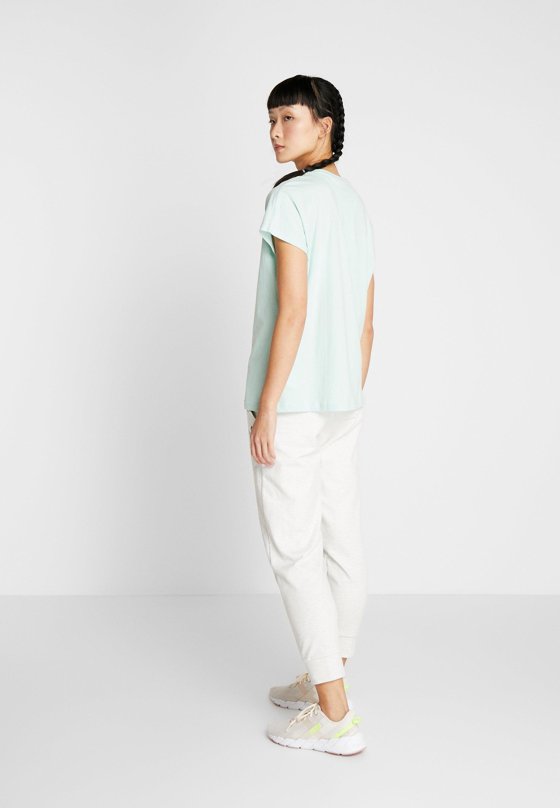 Puma NU TILITY TEE - T-shirts med print - mist green