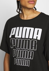 Puma - REBEL LIGHT WEIGHT TEE DRESS - Vestido de deporte - black - 4
