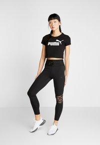 Puma - FITTED TEE - Print T-shirt - puma black - 1