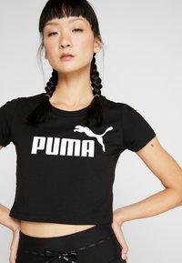 Puma - FITTED TEE - Print T-shirt - puma black - 3