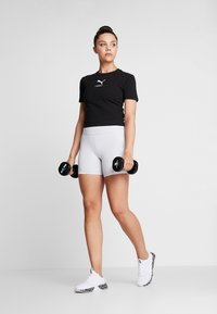 Puma - NU-TILITY FITTED TEE - T-shirt con stampa - black - 1