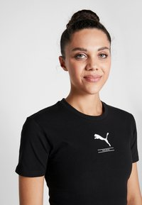 Puma - NU-TILITY FITTED TEE - T-shirt con stampa - black - 3