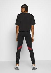 Puma - METAL SPLASH GRAPHIC TEE - Print T-shirt - black - 2