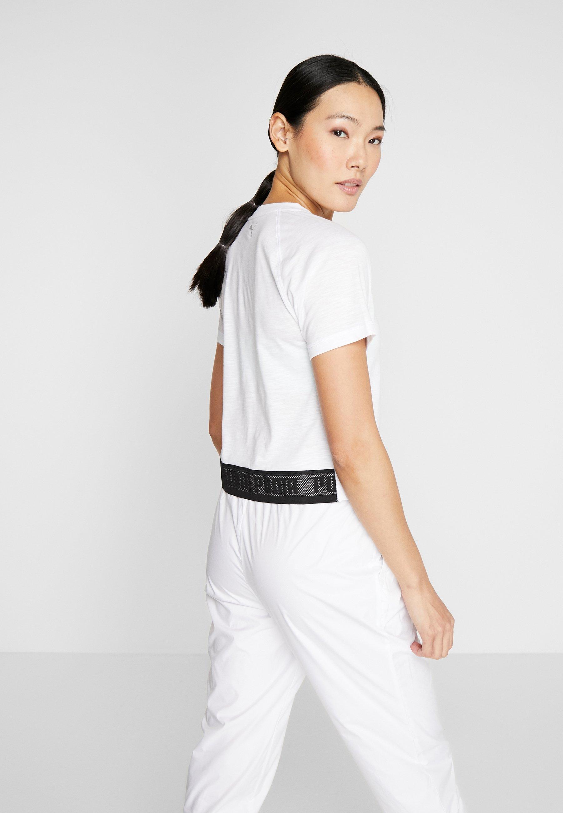Puma LOGO ELASTIC TEE - T-shirts med print - puma white