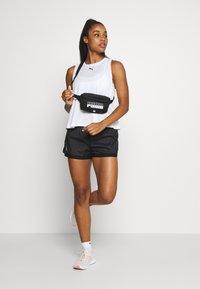 Puma - MODERN SPORTS TANK - Sports shirt - white - 1