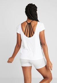 Puma - SOFT SPORTS TEE - T-shirt con stampa - white - 2