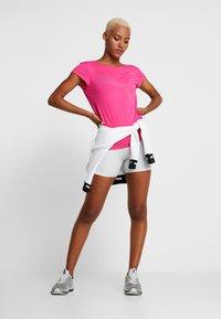 Puma - SOFT SPORTS TEE - T-shirts med print - fuchsia purple - 1
