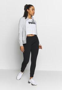 Puma - CROPPED LOGO TEE - T-shirt con stampa - white - 1