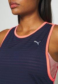 Puma - NEO FUTURE TANK - Sports shirt - peacoat/ignite pink - 6