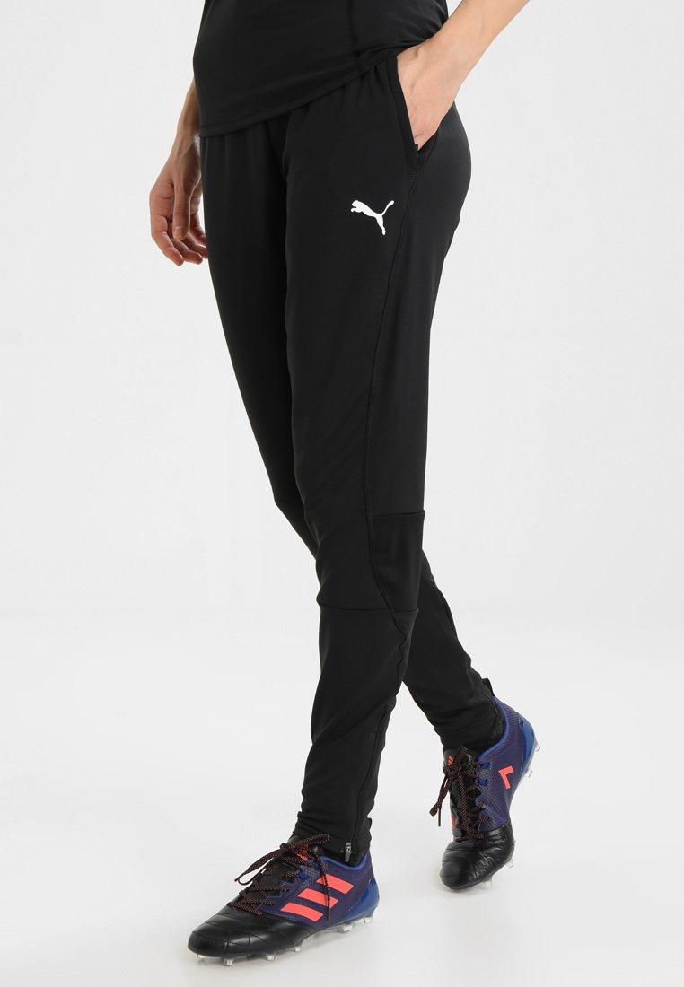 Puma - LIGA TRAINING PANTS  - Jogginghose - black/white